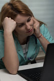 Medical student and her laptop. Medical student is working on her laptop Royalty Free Stock Photography
