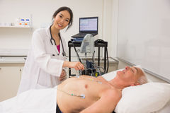 Medical student practicing on older man Stock Images