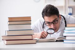 The medical student preparing for university exams. Medical student preparing for university exams Royalty Free Stock Photo