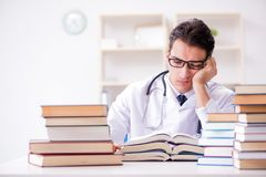 The medical student preparing for university exams Stock Image