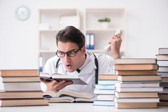 The medical student preparing for university exams. Medical student preparing for university exams Royalty Free Stock Photography