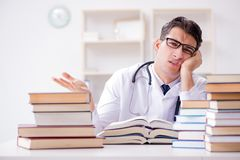 The medical student preparing for university exams. Medical student preparing for university exams Stock Images