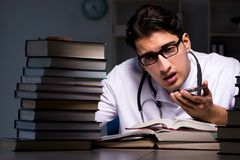 The medical student preparing for university exams at night. Medical student preparing for university exams at night Stock Image