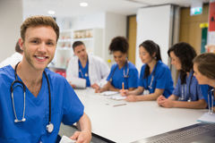 Medical student smiling at the camera during class Stock Photography