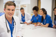 Medical student smiling at the camera during class Stock Image