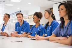 Medical student smiling at the camera during class Stock Images