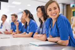 Medical student smiling at the camera during class Royalty Free Stock Photography