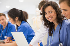 Medical student smiling at the camera during class Royalty Free Stock Image