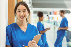 Medical student smiling at camera in hallway. At the university stock image