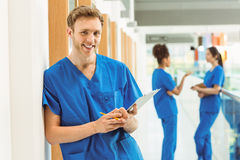 Medical student smiling at camera in hallway Royalty Free Stock Photo