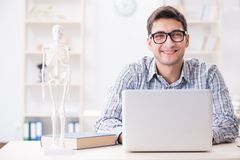 The medical student studing the skeleton. Medical student studing the skeleton Royalty Free Stock Photography