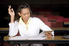 Medical student studying at night in classroom Royalty Free Stock Photography