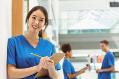 Medical student taking notes in hallway. At the university royalty free stock image