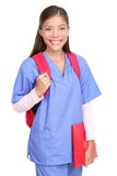 Medical student woman. Medical student. Woman nurse or female medical student smiling with backpack and scrubs isolated on white background Stock Photos