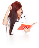 Medical student woman with book. White background Royalty Free Stock Image