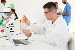Medical student working in scientific laboratory stock photos