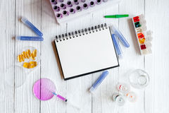Medical student working place at wooden table top view Stock Photo
