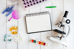 Medical student working place at wooden table top view Royalty Free Stock Image