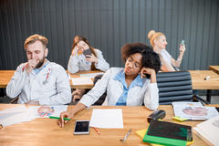 Medical students at the boring lesson Stock Images