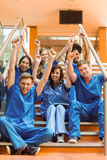 Medical students cheering on the steps Stock Images