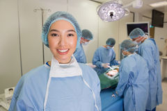 Medical students practicing surgery on model Royalty Free Stock Images