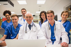 Medical students and professor using laptop Royalty Free Stock Photos