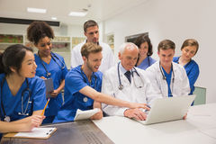 Medical students and professor using laptop Royalty Free Stock Photography