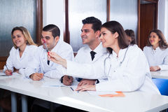 Medical students sitting in audience Stock Image