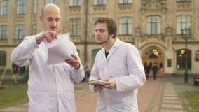 Medical students talks near university stock video footage