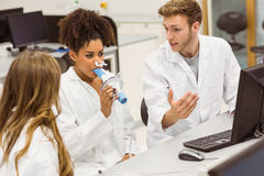 Medical students working together in the lab Royalty Free Stock Photos