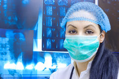 Medical studies and specialization. Young female doctor standing at the table with X-ray,photography Royalty Free Stock Photos
