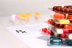 Medical stuff  form - blank prescription and pills on table Royalty Free Stock Images