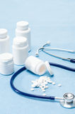 Medical supplies spilled tablets and stethoscope Stock Images