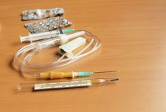 Medical syringe and dropper. On the table stock photo