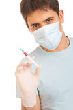 Medical syringe in hands Royalty Free Stock Photo