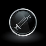 Medical syringe icon inside round silver and black emblem Royalty Free Stock Images