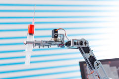 Medical syringe. In robot arm royalty free stock photos