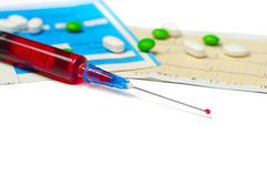 Medical syringe and tablets Stock Images