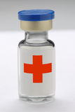 Medical syringe vial. Syringe vial standing alone with red cross insignia Stock Photography