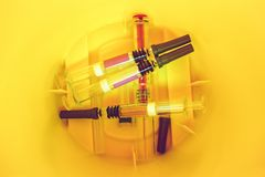 Medical Syringes inside a Sharps Collector stock photography