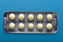 Medical tablet on blue close up Royalty Free Stock Images