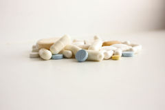 Medical tablets. Handful on a white royalty free stock photo