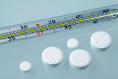 Medical tablets and thermometer royalty free stock photo