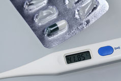 Medical tablets and thermometer royalty free stock photography