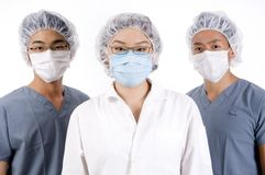 Medical Team. A group of three young asian medical personnel Royalty Free Stock Photos