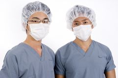 Medical Team. Two young asian men in medical scrubs Stock Photography