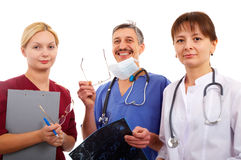Medical team. Nurse, male and female doctor with tomogram Royalty Free Stock Images