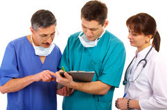 Medical team. Female and male doctors with schedule Stock Photography