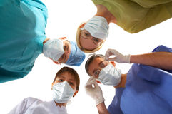 Medical team. Of two men and two women Royalty Free Stock Images