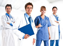 Medical team. Portrait of a smiling doctor and his team Stock Images
